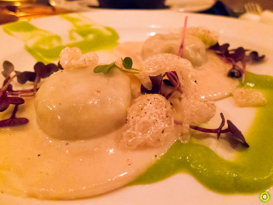 Pork Ravioli w/ apple wasabi butter, rind and radish sprout