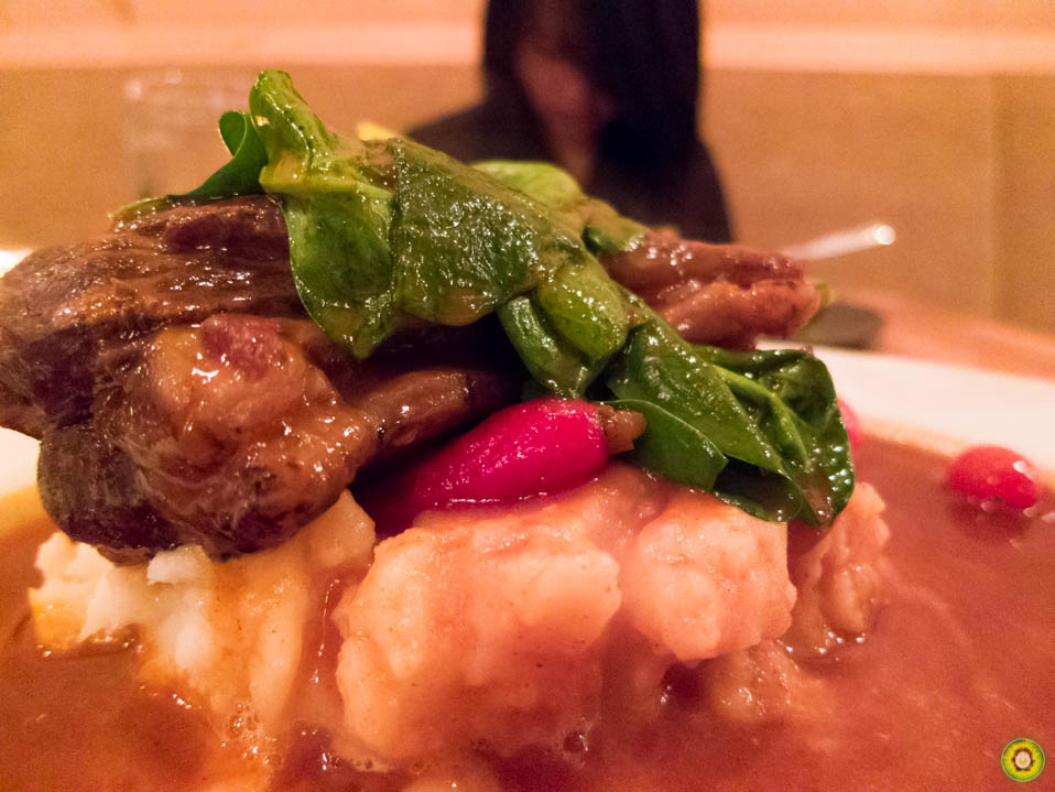 Sous Vide Lamb Shank w/ confit garlic mash, tomato nage, honey roast carrots